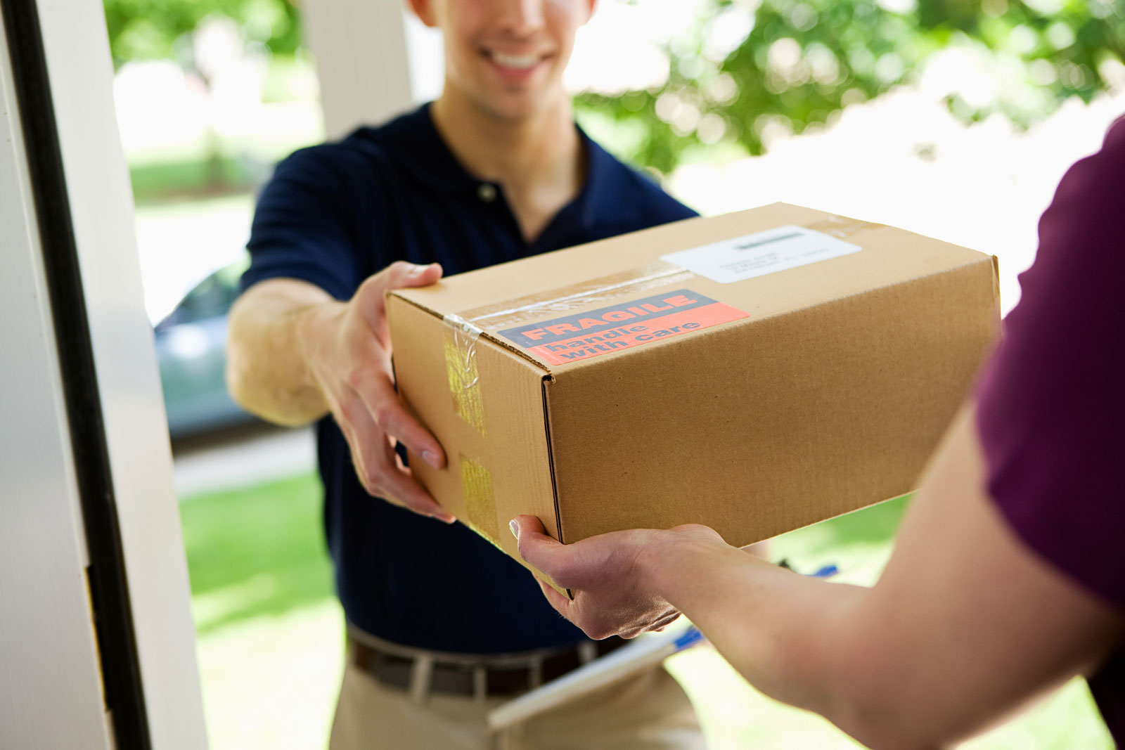 deliveryman delivering package to home