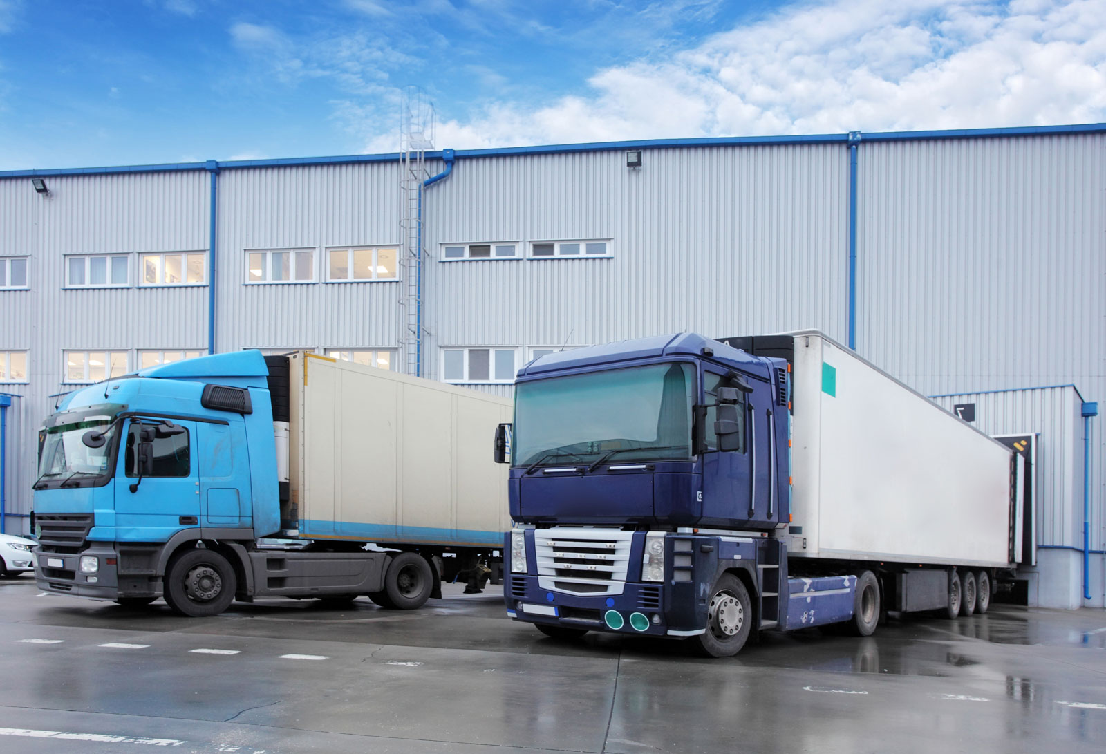 transport trucks at warehouse